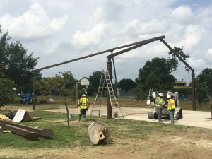 skeleton for basketball court shade being assembled
